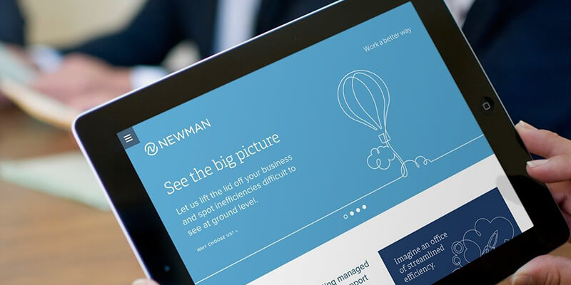 Newman Business Solutions website on a tablet