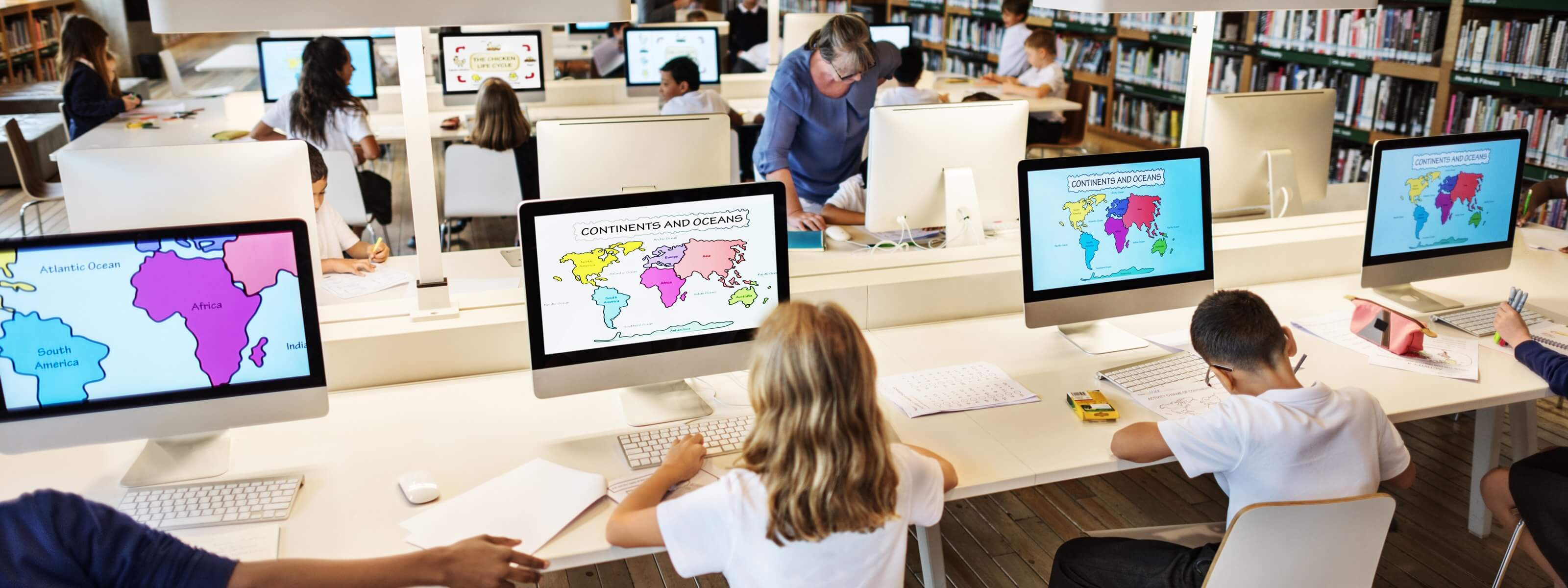 School children using iMacs