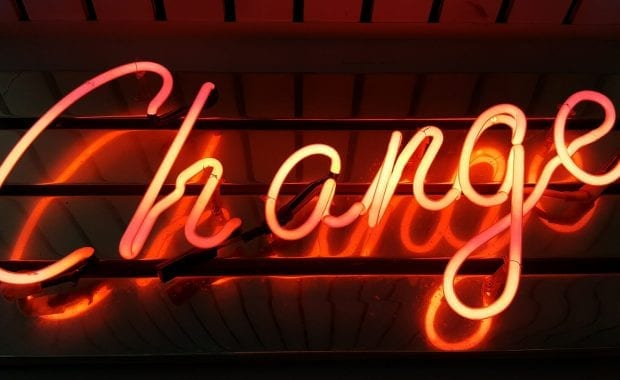 Rebranding — neon sign saying change