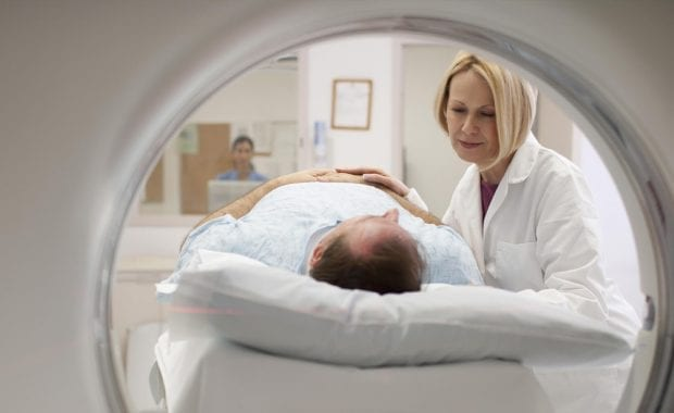 A patient using a MRI scan machine