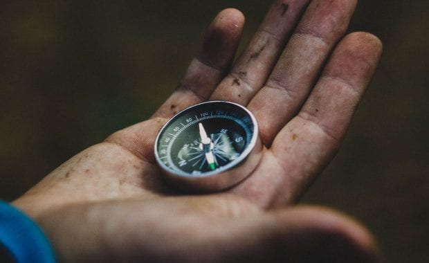 A compass in someones hand