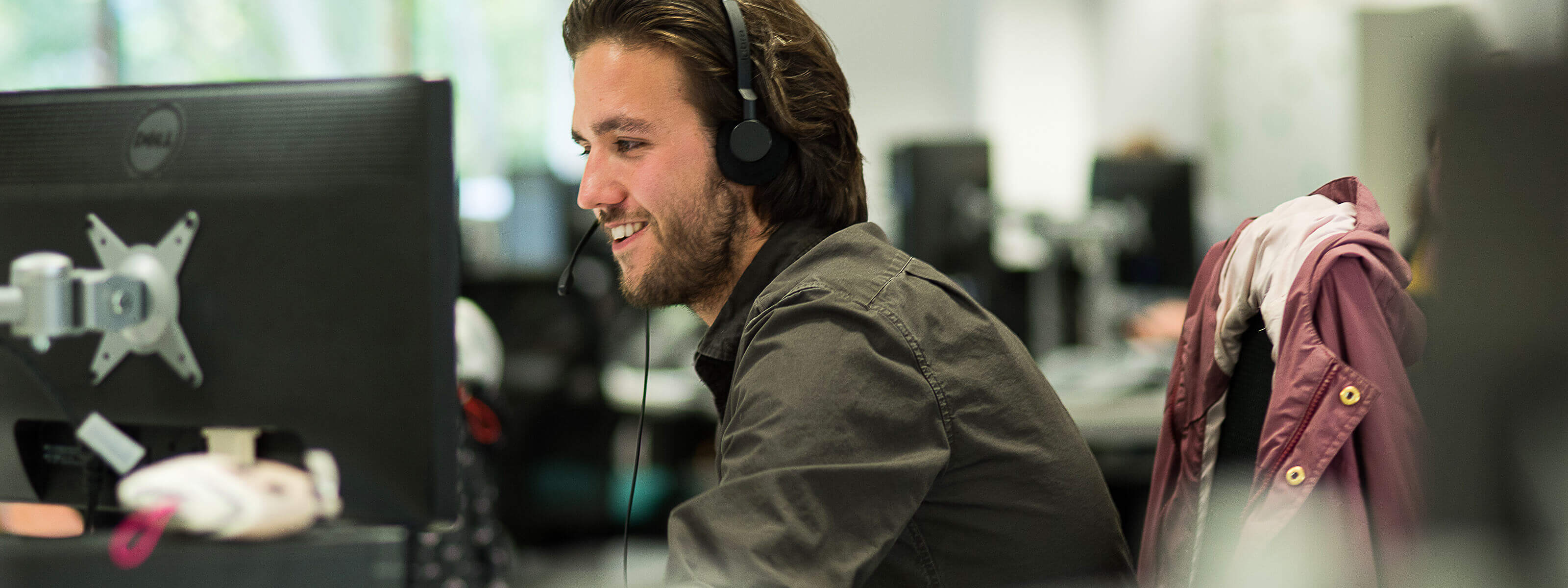 Welbeing employee on a headset